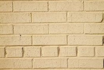 Veneer is a thin layer of real brick that is applied over surfaces.