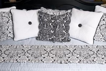 Matching pillows create an updated look with a bed quilt.