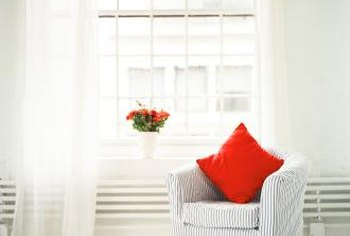 Make dummy curtain panels to soften a window's look.