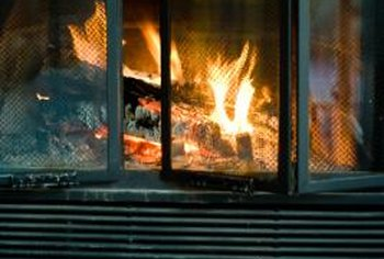 Custom-made glass doors for an L-shaped fireplace offer a clean look.