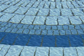 A brush or pumice stone on a long handle will help you clean the bottom of the pool.