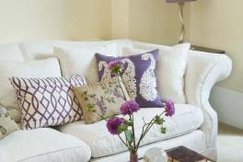 Fanciful fabric appliques and stitched-ribbon designs are creative ways to customize throw pillows.