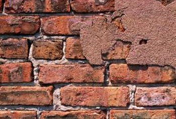 Plaster was often applied to brick walls to conceal the surface of the bricks.