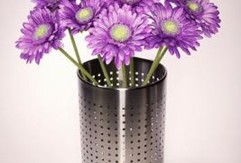 A silver pencil holder modernizes chrysanthemum poms.