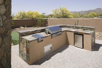 Landscaping adds character and charm to an outdoor kitchen.