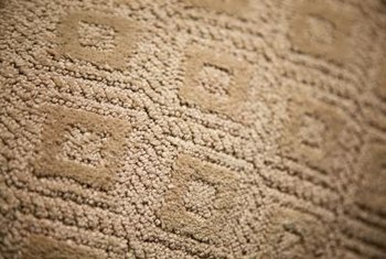 Some patterns on carpet tiles are created by varying textures.