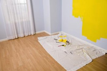 Painters drop cloth serves as a canvas for a hand painted rug.