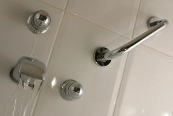Hand rails in the shower help to prevent slips and falls.