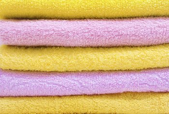 Brighten your bathroom with a curtain made from a colorful towel.