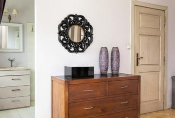 A table or chest of drawers acts as a pedestal for decorative home accessories.