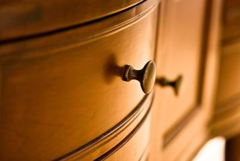 Fabric-covered knobs help personalize your dresser.