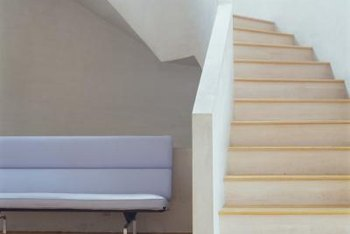 Paint the trim so that it matches the walls at each side of the stairs.