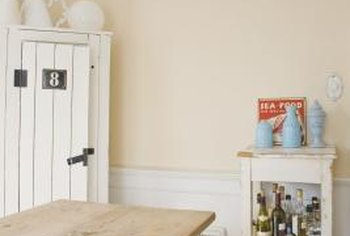 Paneled wainscoting helps create a more polished room, but you can fake the look with a little paint.