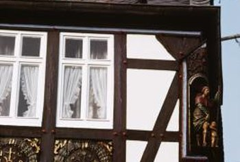 Timber framing and stucco are distinctive Tudor-style features.