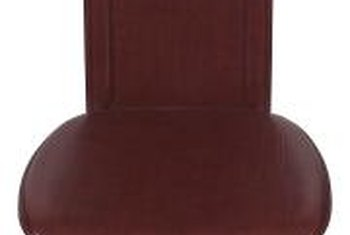 Make an old, dark leather chair vibrant with a new bright color.