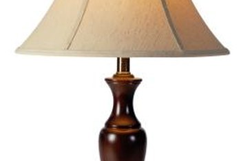 A bell shade complements the contours of the lamp base.