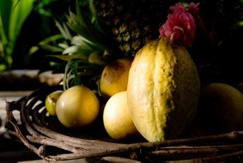 Exotic fruits and flowers make excellent tropical centerpiece elements.