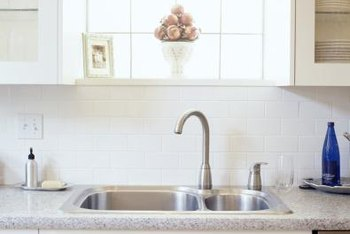 Classic white tile is an obvious backsplash choice for a kitchen with white cabinets.