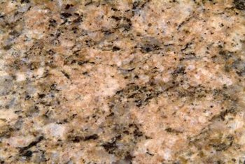 Faux painting gives laminate countertops the look of granite.