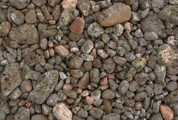 Stone or gravel mulch looks natural in a rock garden.
