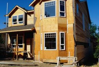 Both plywood and oriented strand board are common sheathing materials.