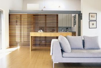 A sliding screen can separate two rooms.