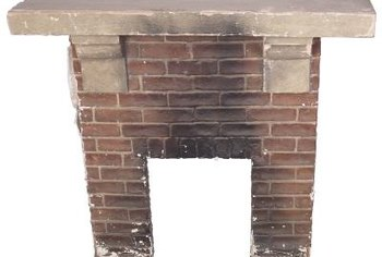 Refurbish a fireplace by removing the brick facade.