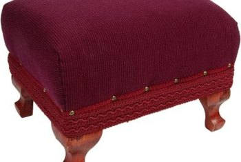 Add decorative trim and tacks, if desired, once the upholstery is finished.