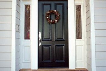 This Stylish Front Door Is Framed By An Arch Shaped Transom Window And Dual  Sidelights