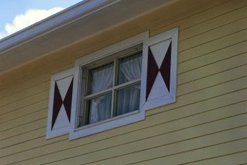 Decorative shutters help pull the eye away from flat roof lines.