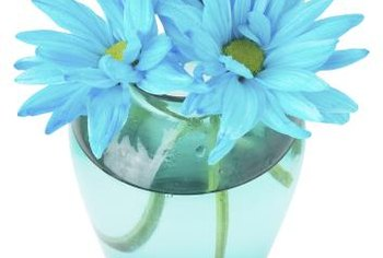 A teal vase catches the light for a subtle accent.