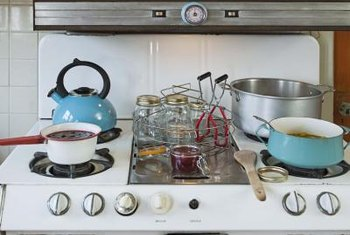 Enamel cooktops tolerate abuse and energetic cleaning better than glass tops.