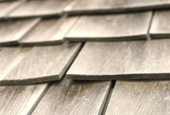 Proper insulation inside the attic reduces heat loss through shingles.