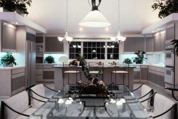 Properly placed lighting adds drama to the kitchen.