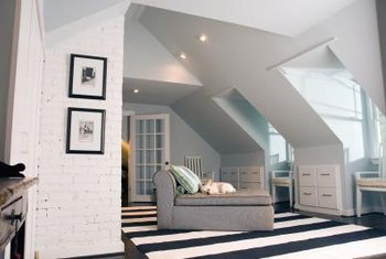 The sloped ceiling of an attic room presents multiple challenges.