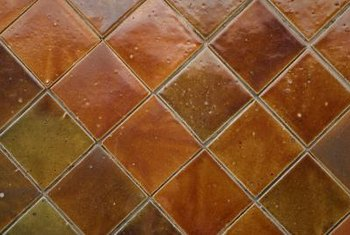 Use real copper tiles instead of colored ceramic to bring the warm color into your kitchen.