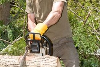 Cutting a tree with a chainsaw requires skill and caution.