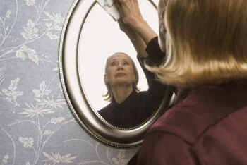 Use newspaper or a clean, soft, lint-free cloth to avoid mirror smears.