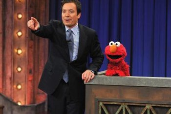 "Elmo makes the talk show rounds, including ""Late Night with Jimmy Fallon."""
