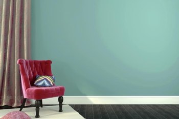 Stark White Baseboards Heighten The Contrast Between A Strong Wall Color And Floor