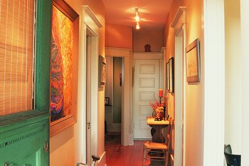 Color and light are critical to eliminating shadows, which often make long hallways feel cramped and gloomy.