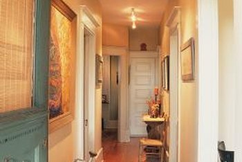 Hanging a large painting or print on the wall gives life to a small hallway.