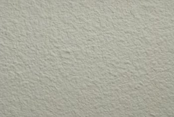 Textured plaster contains bits of aggregate.