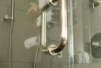 Handles and pulls attach through the glass of frameless shower doors.