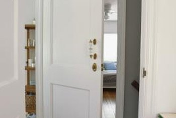 Loose hinges can cause door problems.