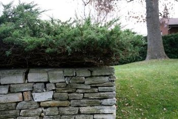 Landscape fabric protects a retaining wall's strength and durability.