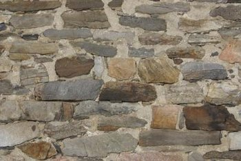 Painting a stone wall white brightens a room. & How to Paint an Indoor Stone \u0026 Mortar Wall White | Home Guides | SF Gate