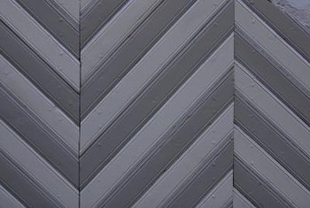 Alternating strips of wood creates a chevron pattern on a floor.