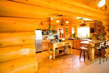 Go for a log cabin feel by pairing your knotty pine cabinets with wood countertops.