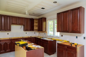 Refinishing Kitchen Cabinets With Cream Paint & Glaze